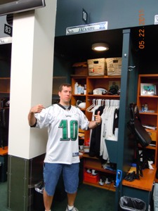 This is me with some goofy look on my face while standing at DeSean Jackson's locker.  Photogenic I am not.