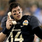 """""""Is that you Chip?  Yes sir, I love Tostitos too!""""  Photo: Ross D. Franklin/AP"""